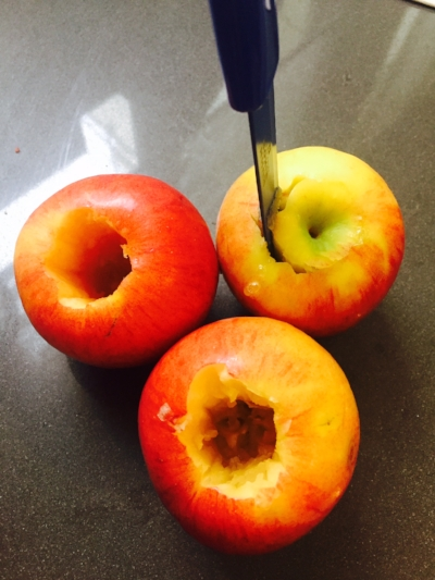 Cored apples (I just used a sharp knife) be sure not to go all the way through the bottom.