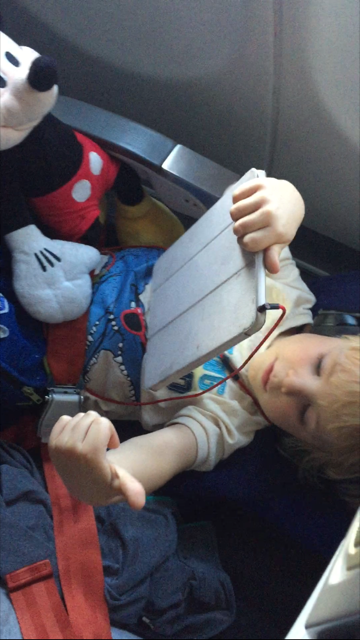 My 4.5 year old very comfy after takeoff