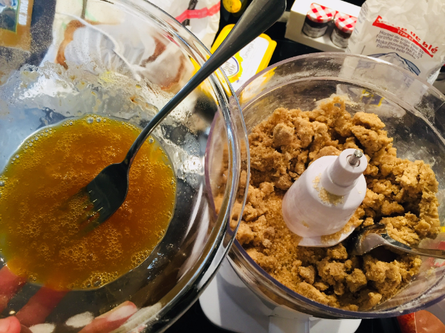 Stir sugar into dry ingredients & add the wet mixture (egg & syrup)