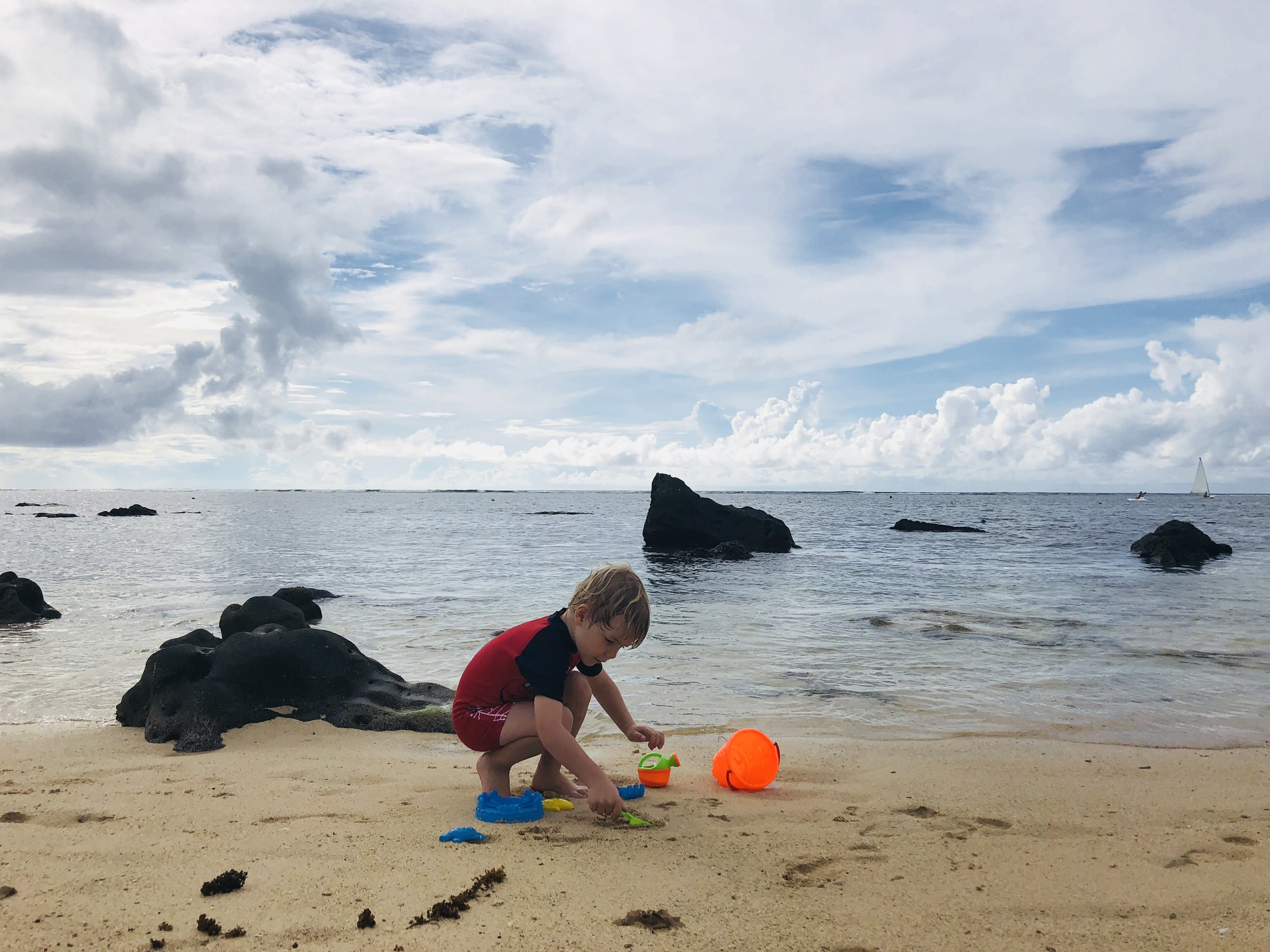 My older son enjoying the beautiful sand & crystal clear water