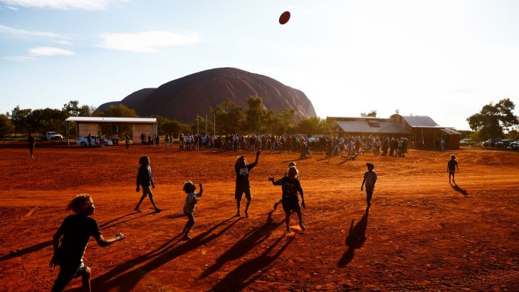 Children playing footy during the closing ceremony in the Mutitjulu community of the First Nations National Convention held in Uluru. Photo: Alex Ellinghausen