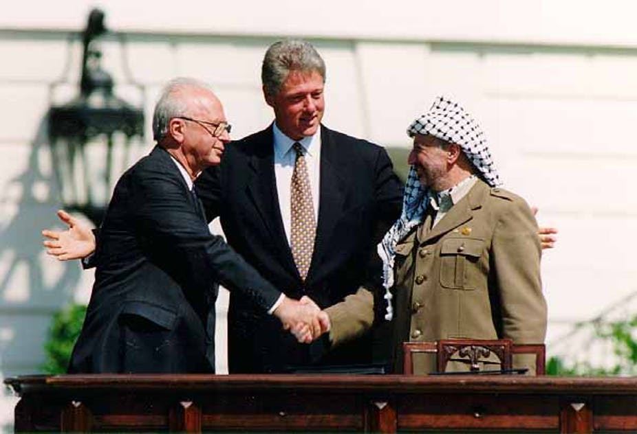 US President Bill Clinton, Israeli Prime Minister Yitzhak Rabin and Palestinian leader Yasser Arafat sign the historic Oslo accord at the White House in September 1993. Wikicommons/Vince Musi