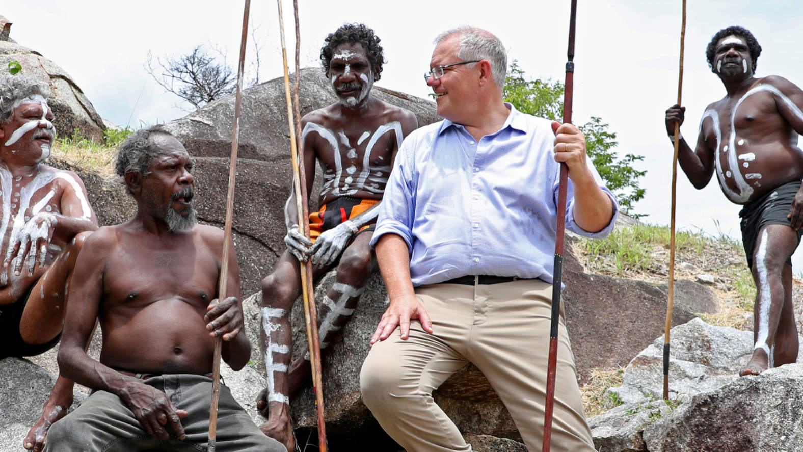 Prime Minister Scott Morrison with the people of the Guugu Yimithirr tribe at Reconciliation Rocks, Cooktown. Credit:AAP