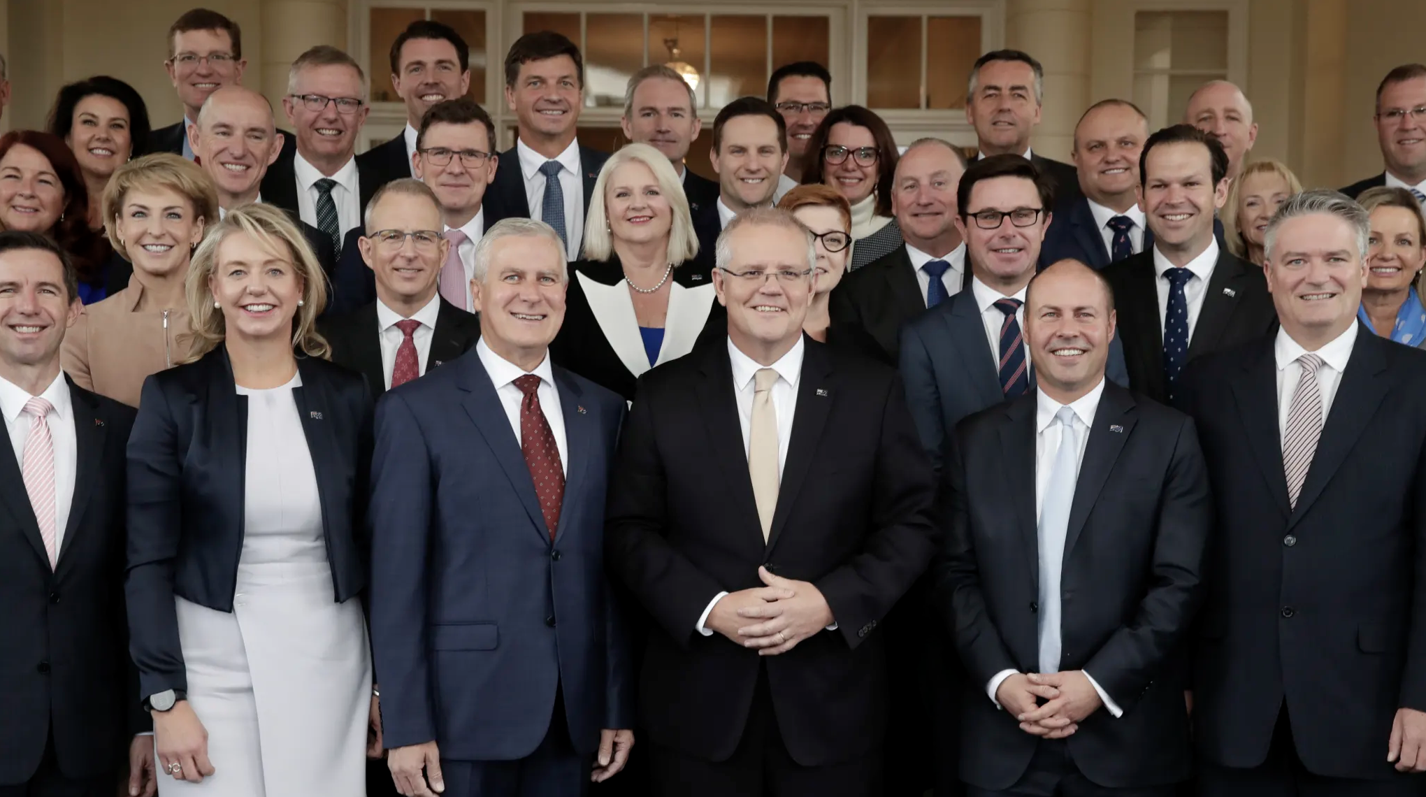 Prime Minister Scott Morrison with his new-look ministry after the swearing-in ceremony. Credit:Alex Ellinghausen