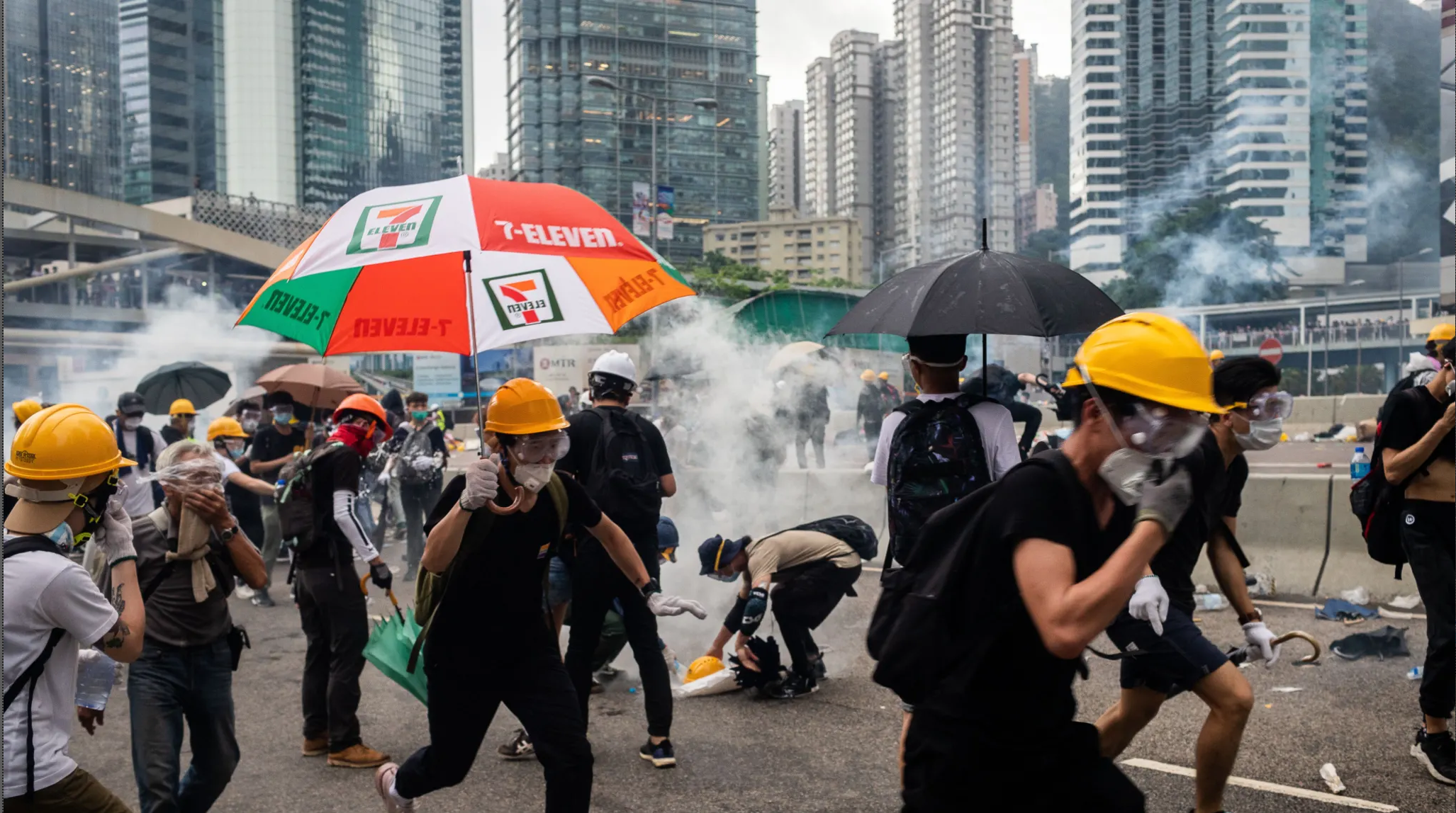 Demonstrators in Hong Kong disperse as the police fire tear gas. Credit:Bloomberg