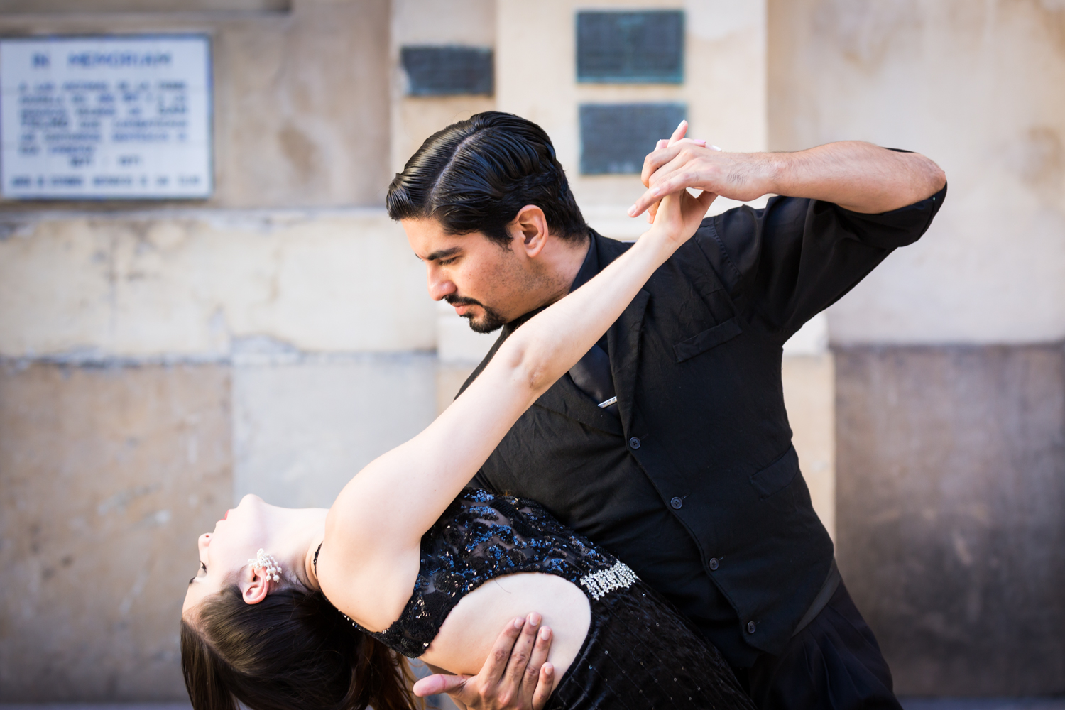 Two tango dancers dancing on the streets of Buenos Aires by NYC photojournalist, Kelly Williams