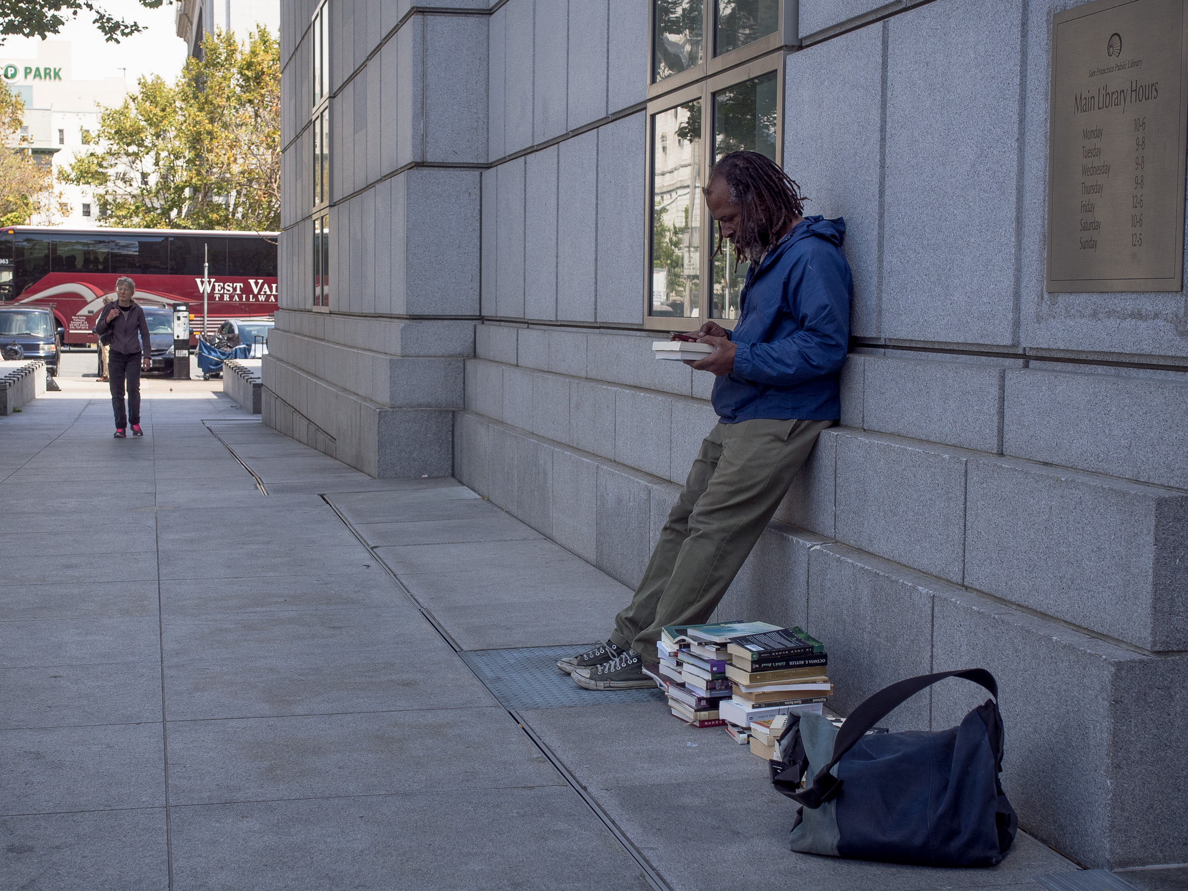 Book denizen checking out his spoils from the Dollar sale, 12:40pm