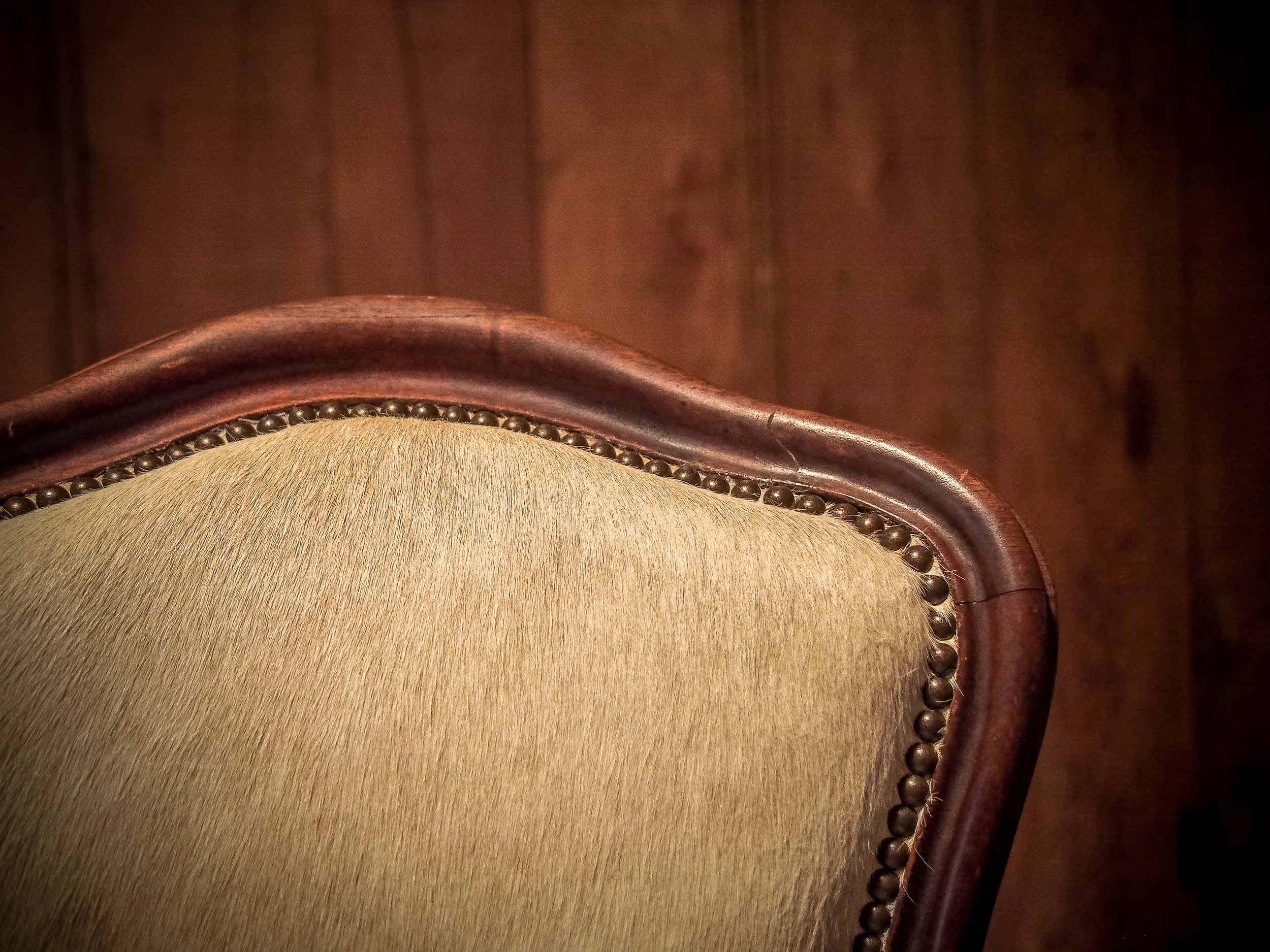 Antique chair re-covered in rawhide