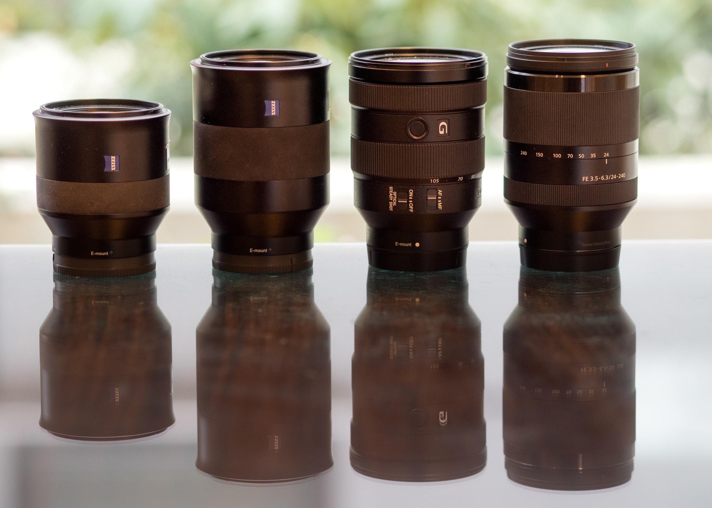 L to R: Batis 1.8/85, Batis 2.8/135, f4/24-105 G, f3.5-6.3/24-240 (taken with Olympus 75mm f/1.8)