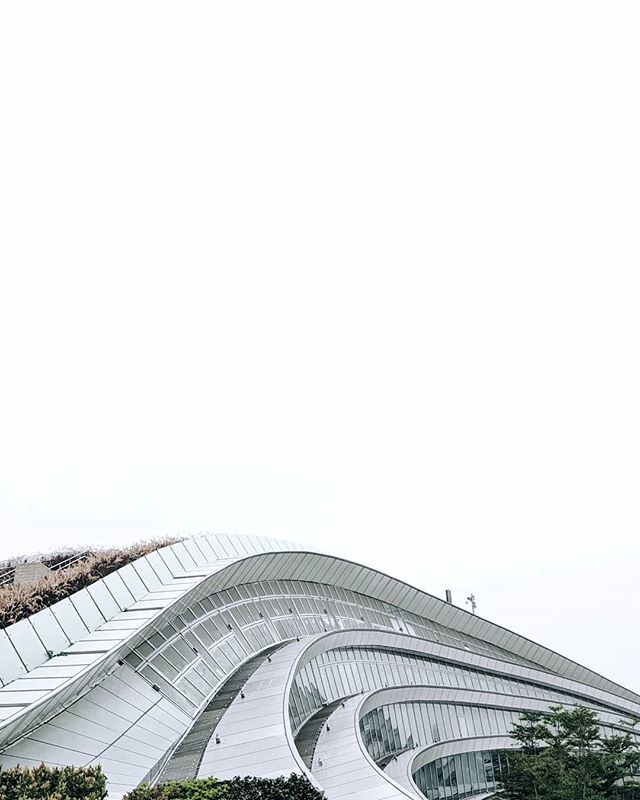 Hadid-esque waves 🌊 . . . . . . . . . . #architecture #building #architexture #city #buildings #skyscraper #urban #design #minimal #cities #town #street #art #arts #architecturelovers #abstract #lines #instagood #beautiful #archilovers #architectureporn #lookingup #style #archidaily #composition #geometry #perspective #geometric #pattern