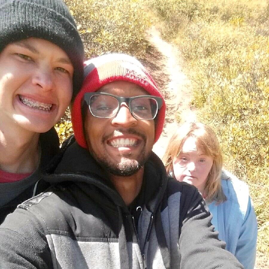 Aaron (center) takes a hike with Sean and Bethany.
