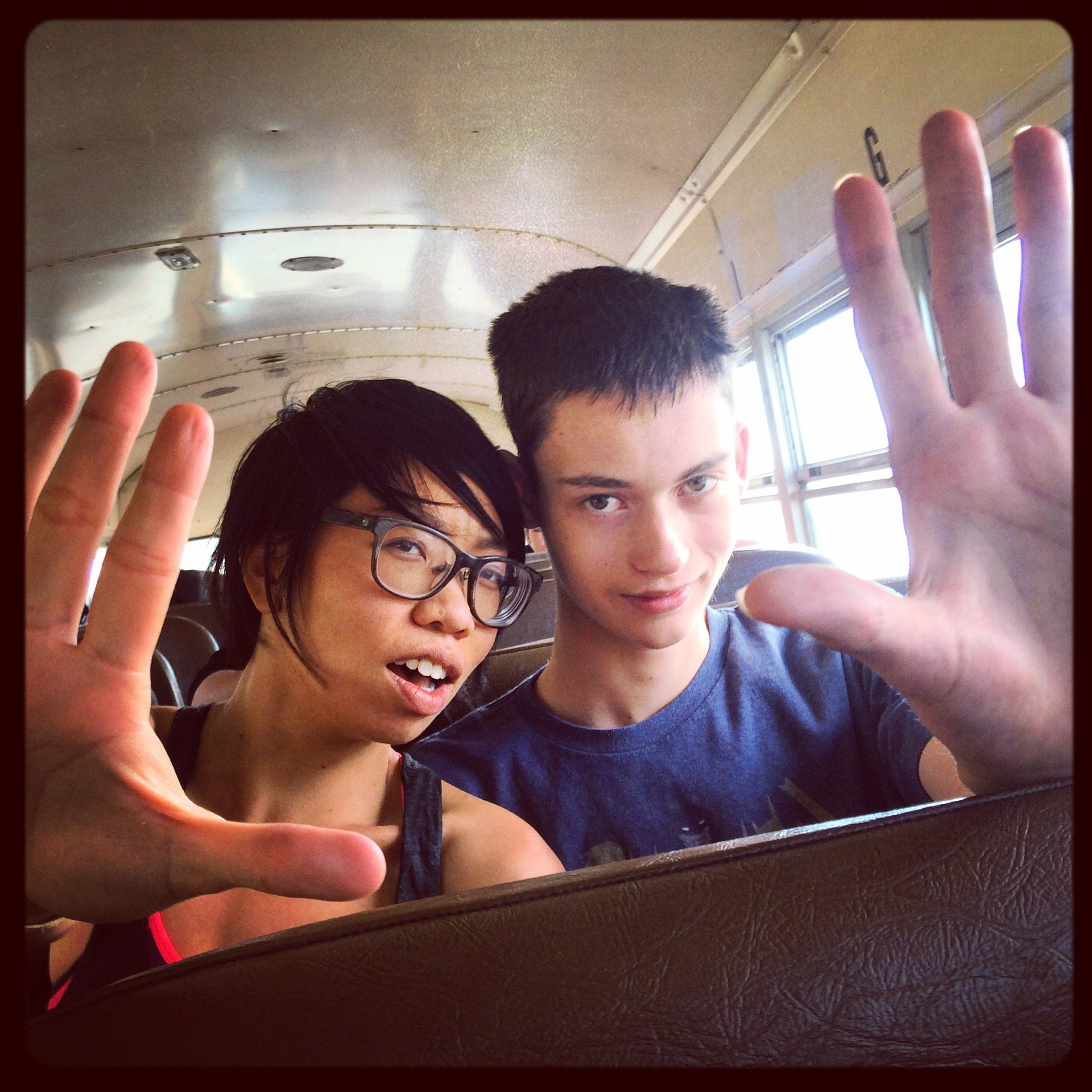 Anh and Michael kick it on the bus.