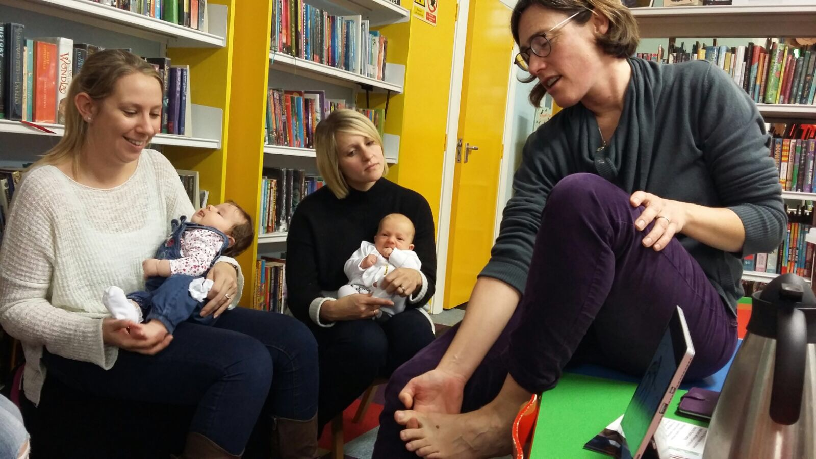 Mums at the Baby Latte meeting learning some reflexology tips to use with their babies