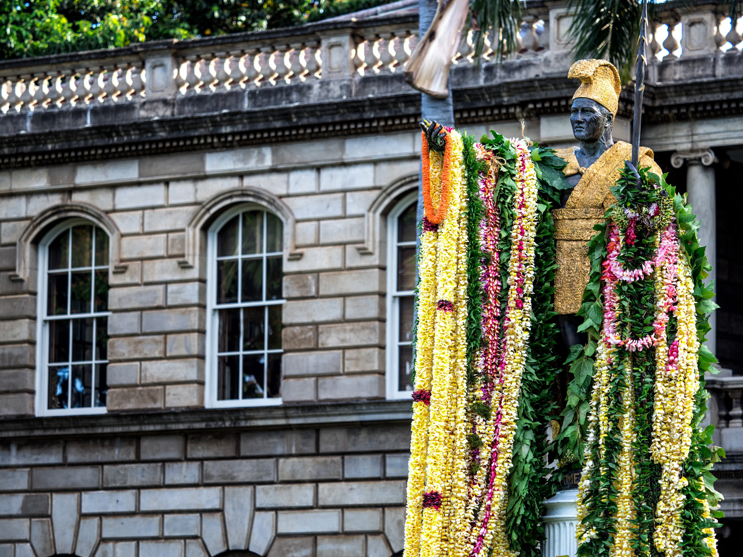 Kamehameha is decorated with leis outside Ali'iolani Hale in Honolulu. The same ceremony occurs in the King's birthplace of North Kohala, on the Big Island.