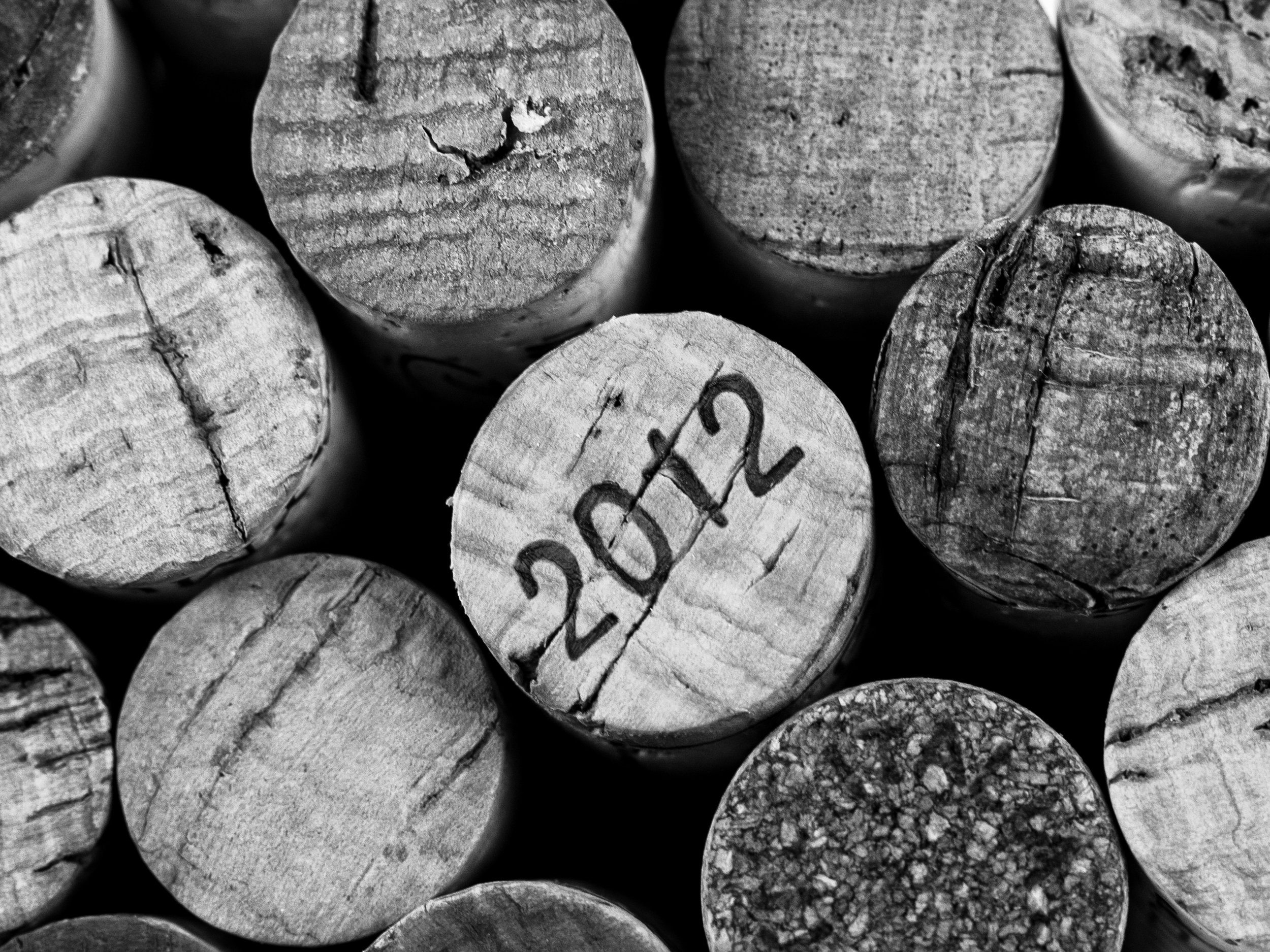 Musings by the Glass - Cork vs Screw Cap - Corks Black and White