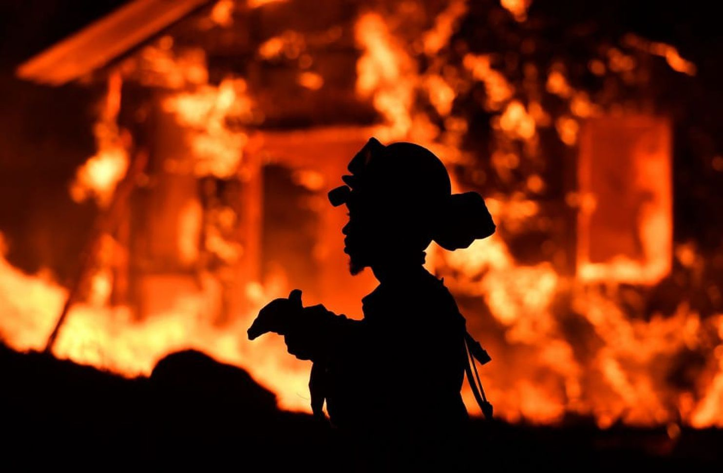 From the Washington Post: A firefighter monitors flames as a house burns near Napa. (Josh Edelson/AFP/Getty Images)