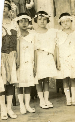 My grandmother (with the flower headband) shortly after being adopted.