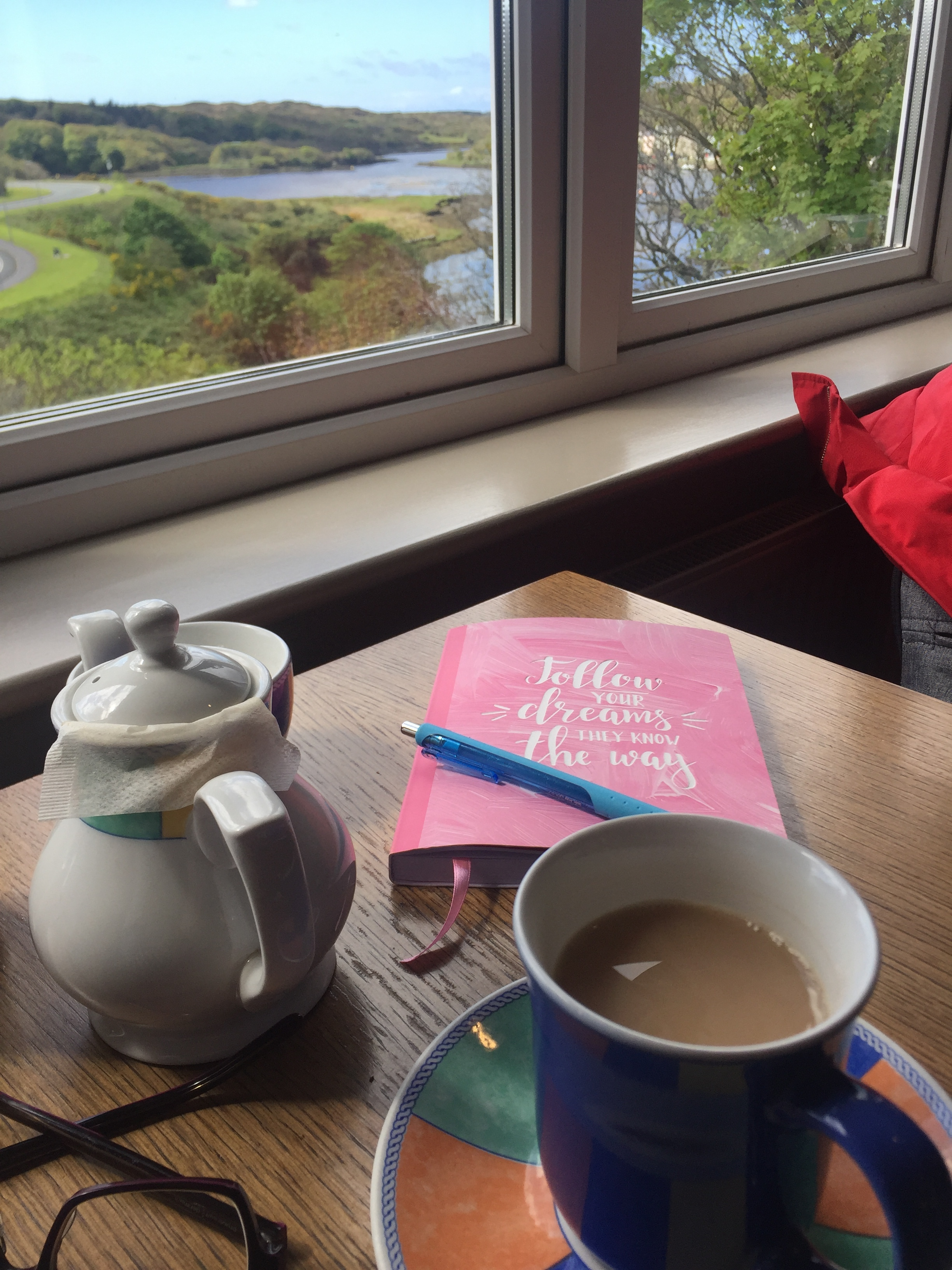 My daily writing spot at the cafe in Clifden with the view of the bay