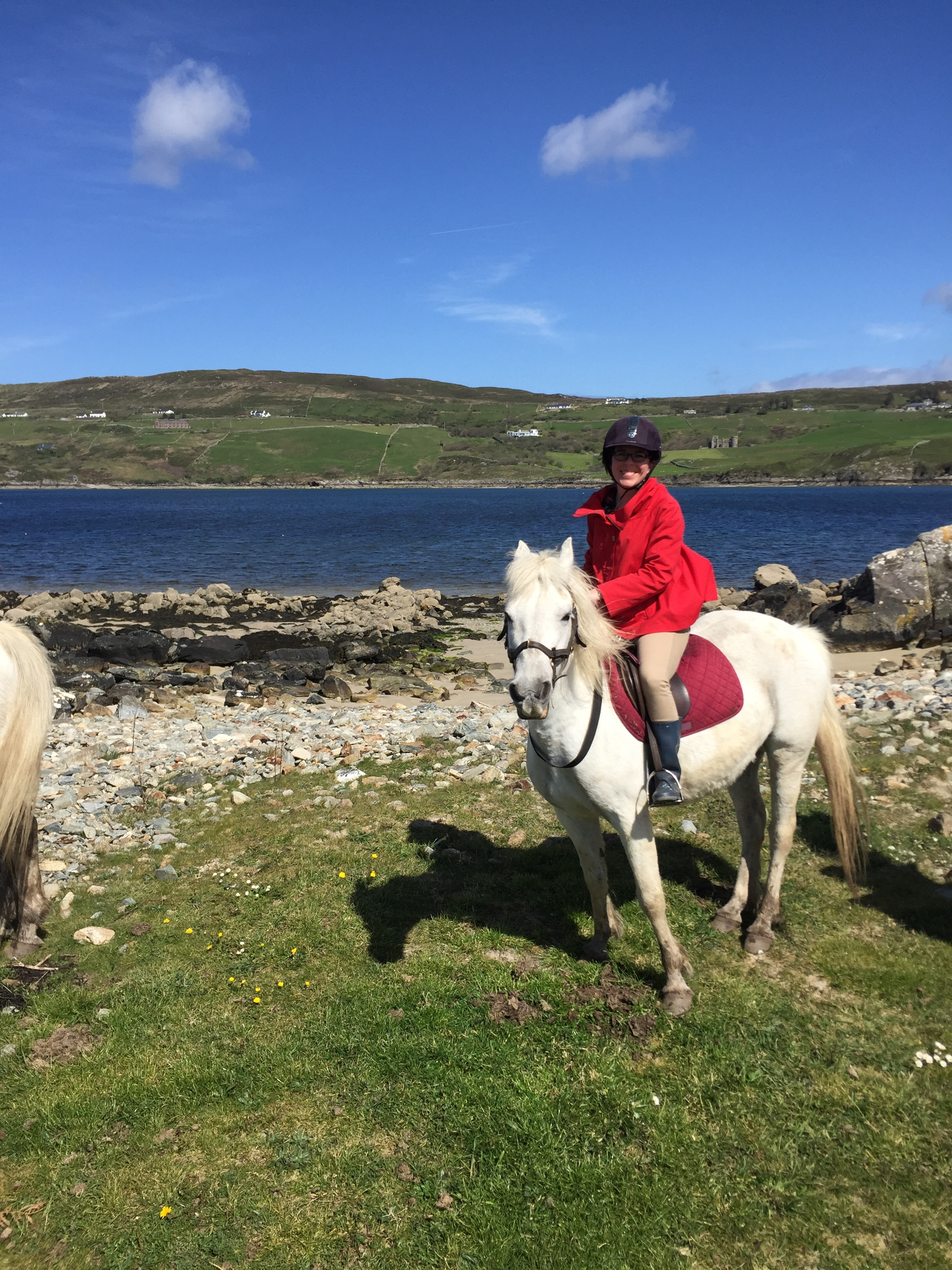 Riding with Jannissa, my sweet Conemara Pony, in Errislannan. Clifden Bay and Clifden Castle in the background.