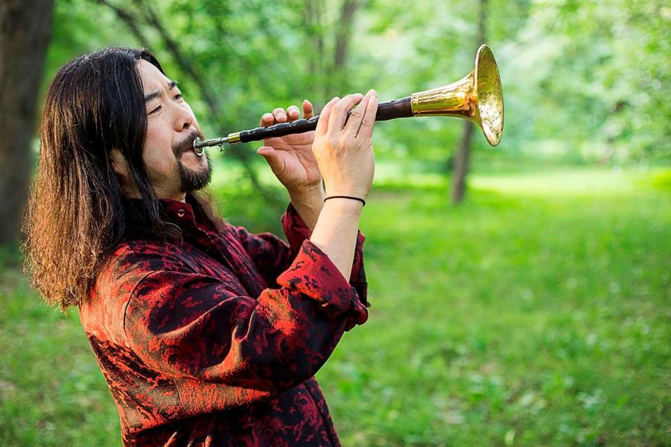 Yazhi Guo, photo source:  TheBostonGlobe