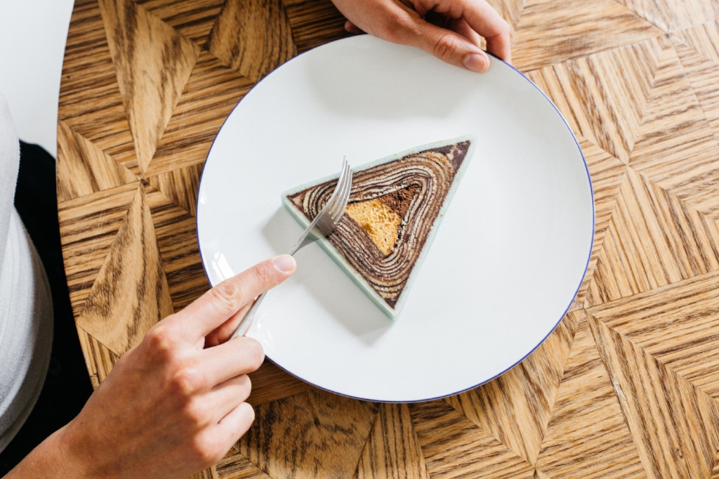 One of the cakes cut. The taste gradates from roasted almond to dark chocolate mousse and not two pieces tastes or look the same.Photo:  Dunja Opalko