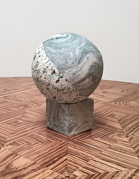 Spherical cake, covered in fondant.