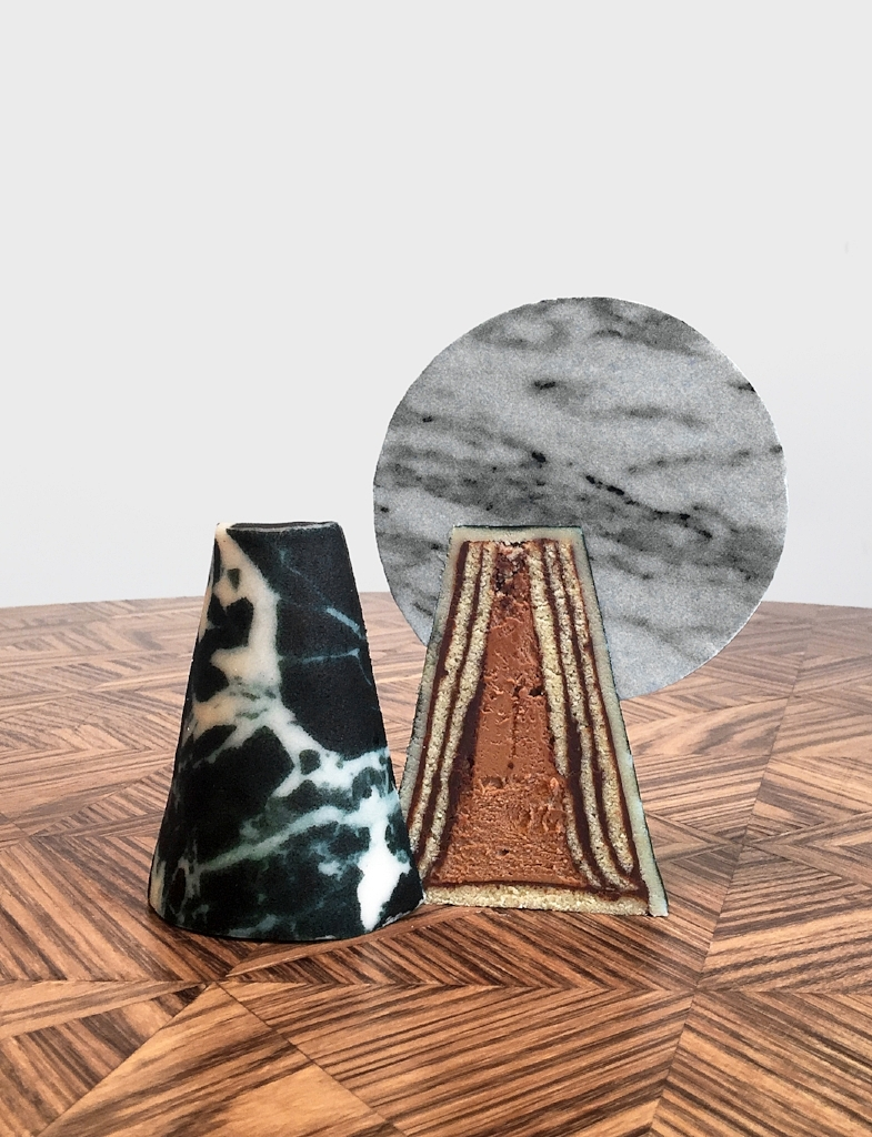 Cone cake, black and white marble prints, cut open.