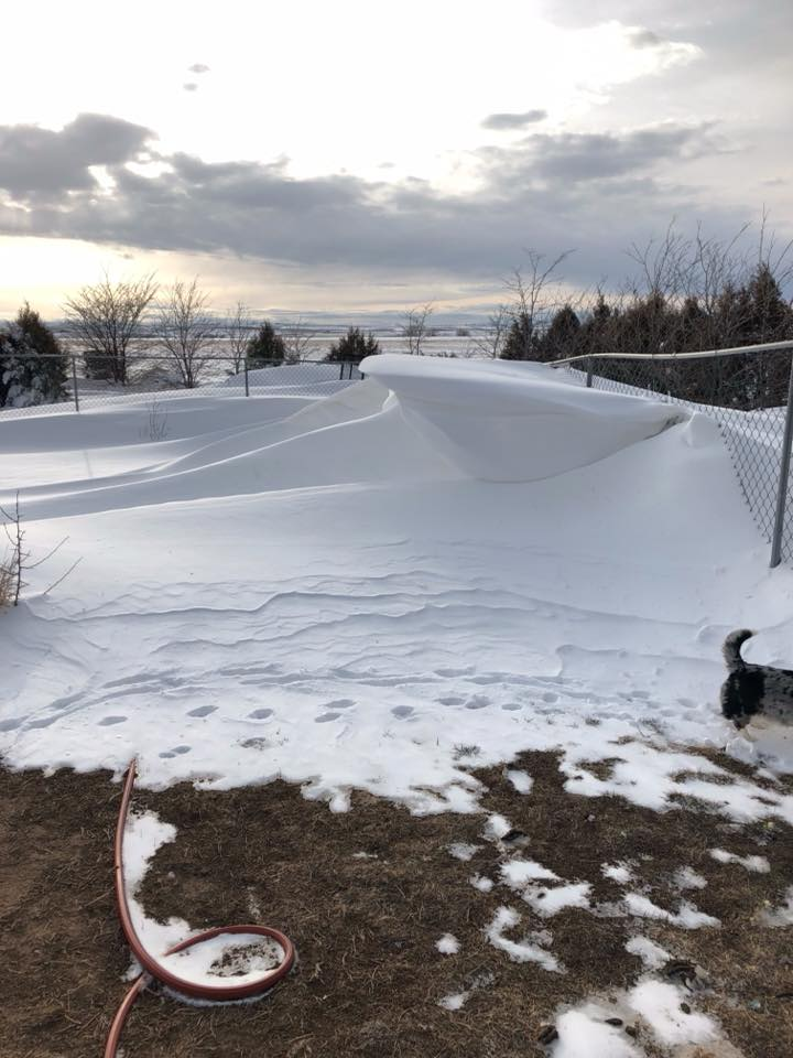 Six foot drifts in Bennett, Posted March 14, 2019. Colorado. (Part of the point of this image is how a major blizzard can leave areas of bare ground next to deep drifts. It's not the amount of snow that falls, but rather the wind and movement of snow that is so pronounced.) Photo: Linda Masters.