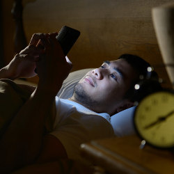 using mobile phone in bed