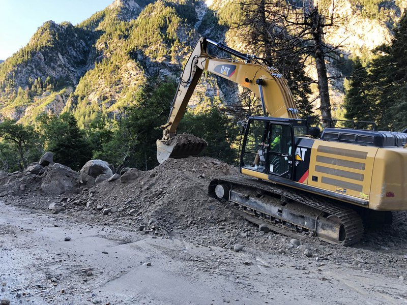 Photo courtesy of John Gleason UDOT - Heavy machinery remove mud and rocks from the road in Little Cottonwood Canyon, Friday, Aug 9 2019.