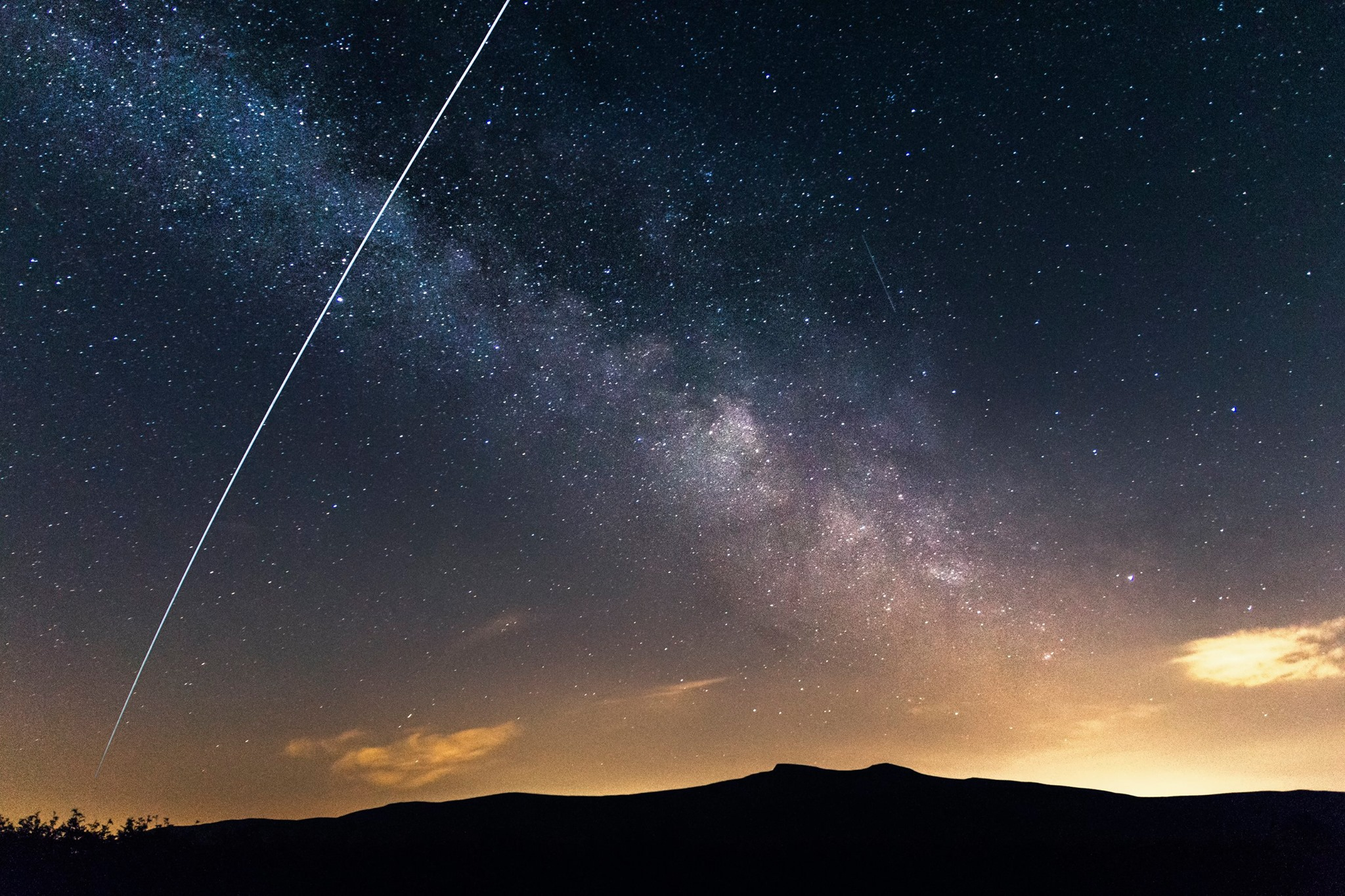 The International Space Station cutting across the Milky Way above the Brecon Beacons taken by workshop attendee Mark Kent.