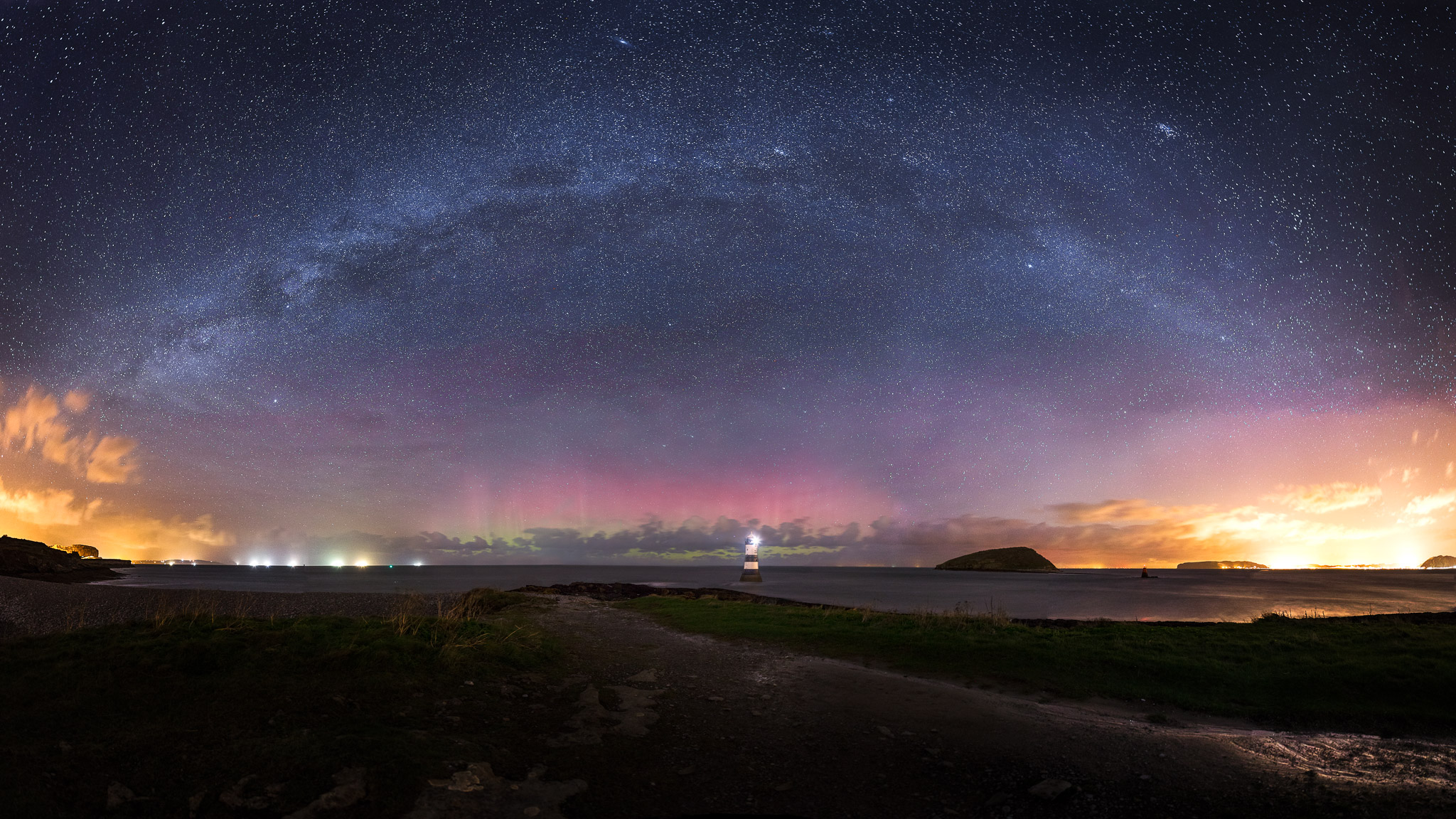 Penmon lighthouse under the Milky Way and Northern Lights