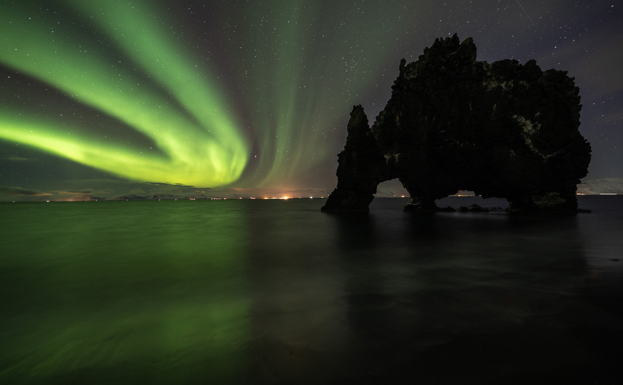 Gorgeous aurora bows at Hvitserkur, North Iceland