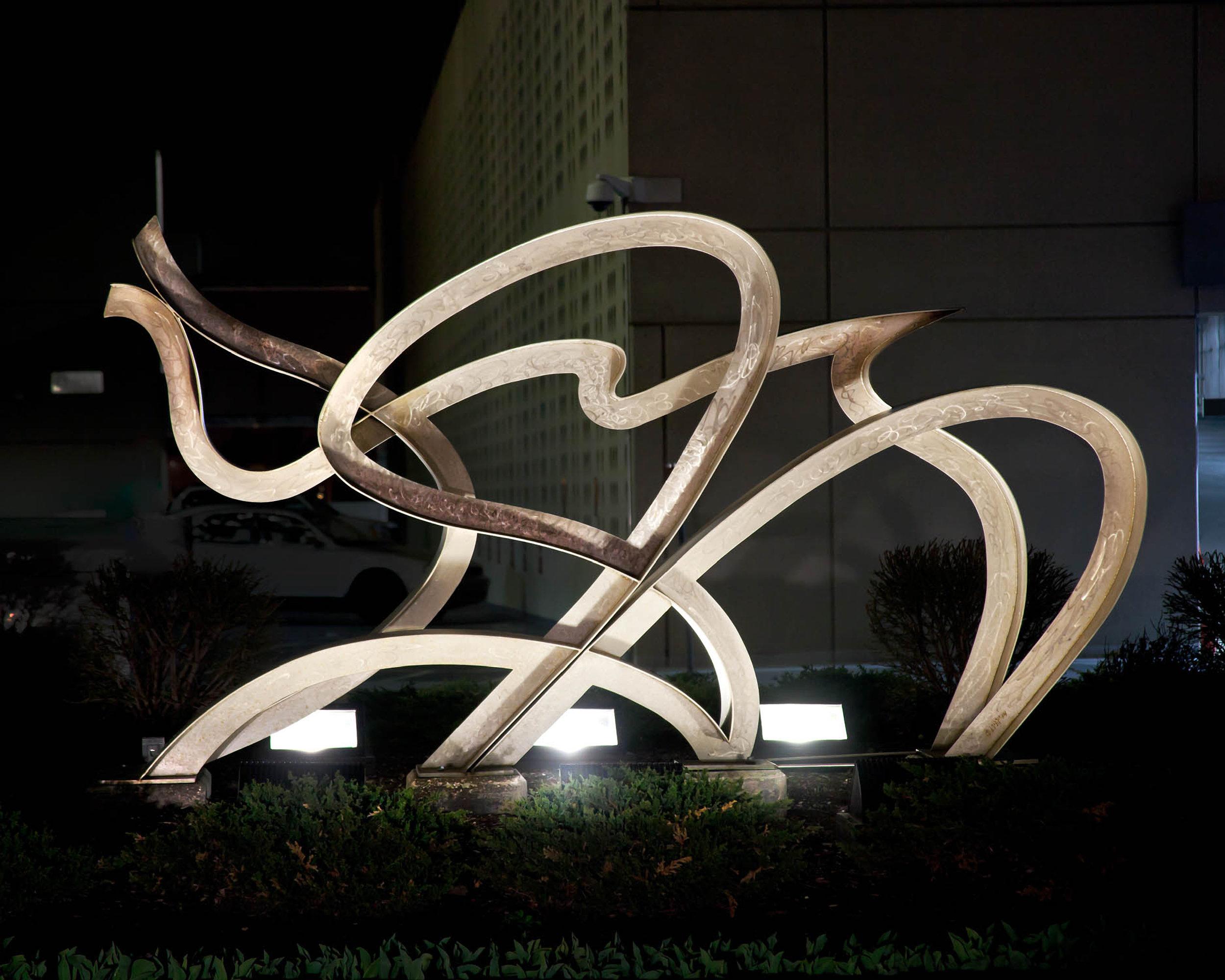 Freedom  2004, stainless steel, 6x11x2 ft  Plaza Library 4801 Main Street Kansas City, MO