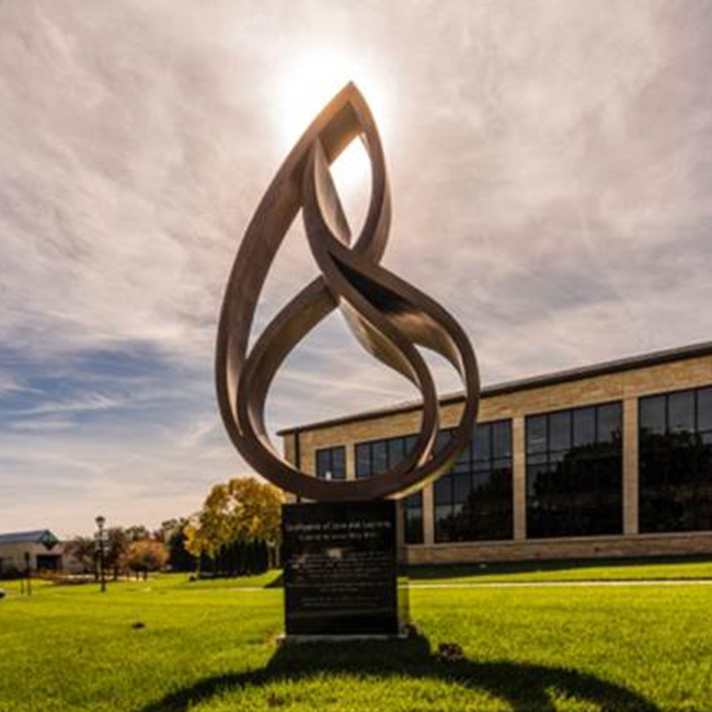 Confluence of Love and Learning  2015, bronze, 12 ft on a 4-ft base