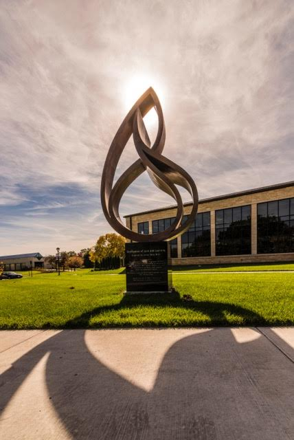 Confluence of Love and Learning  2015, bronze, 12 ft on a 4 ft base Pictured at Washburn University