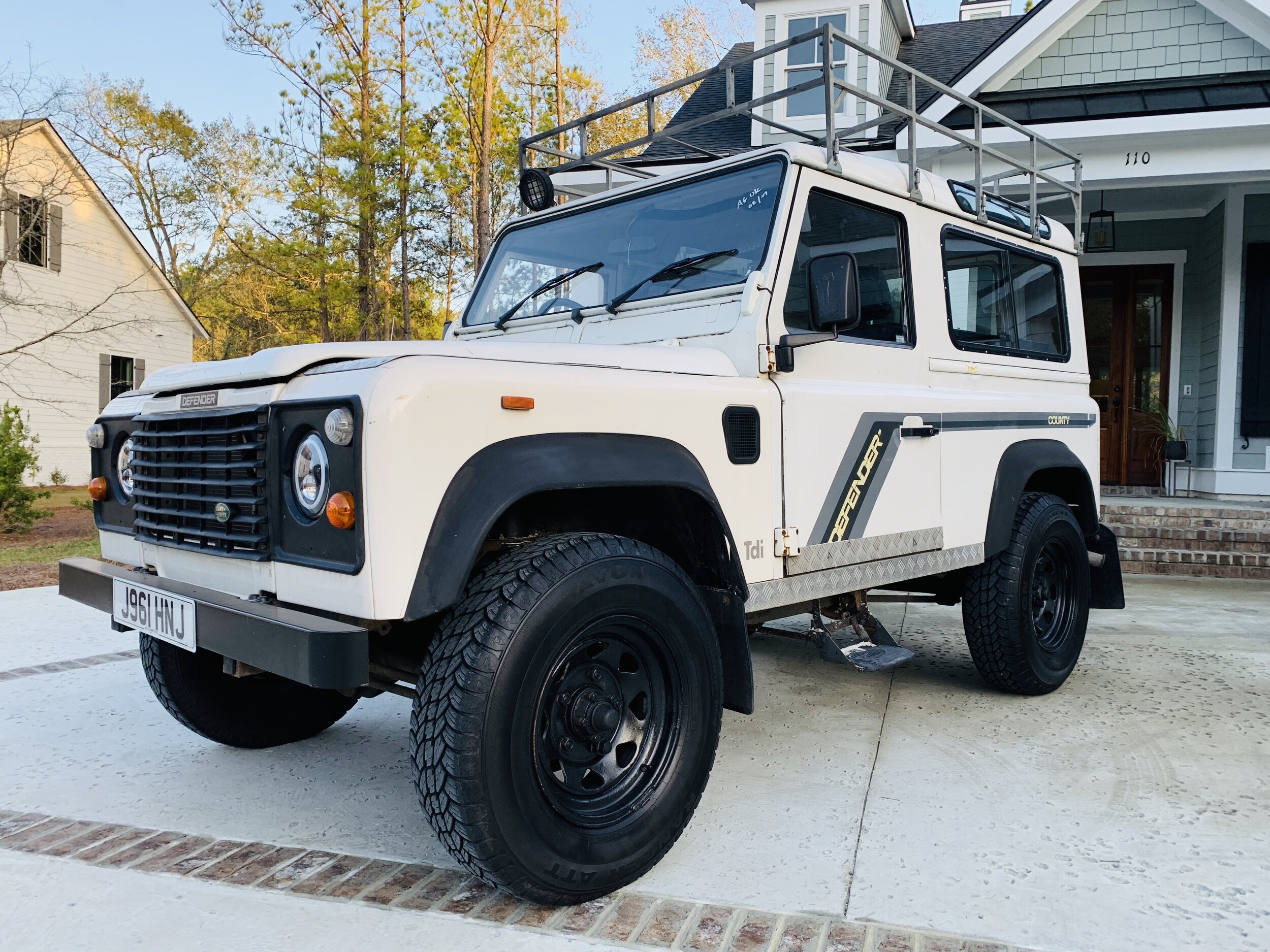 1992 Land Rover Defender 90 County - In classic white, this gorgeous example is equipped with roof rack for gear. Modern LED HALO headlights add a modern touch & custom interior.$26,000. SOLD