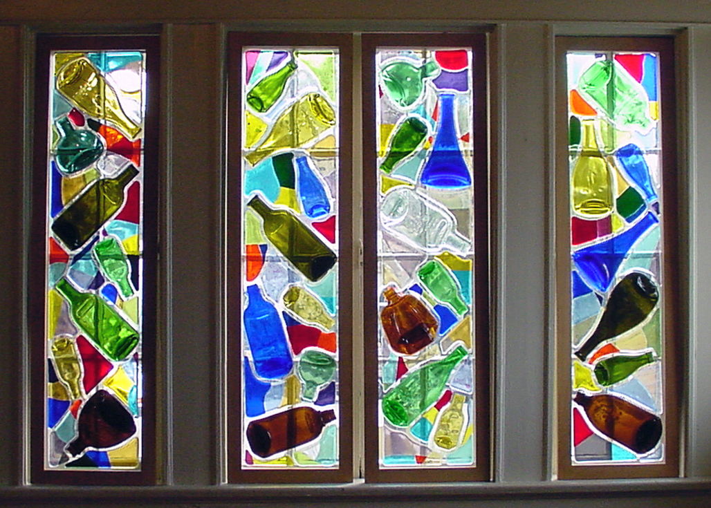 Flattened Wine Bottles attached to Windows Around Fused Glass