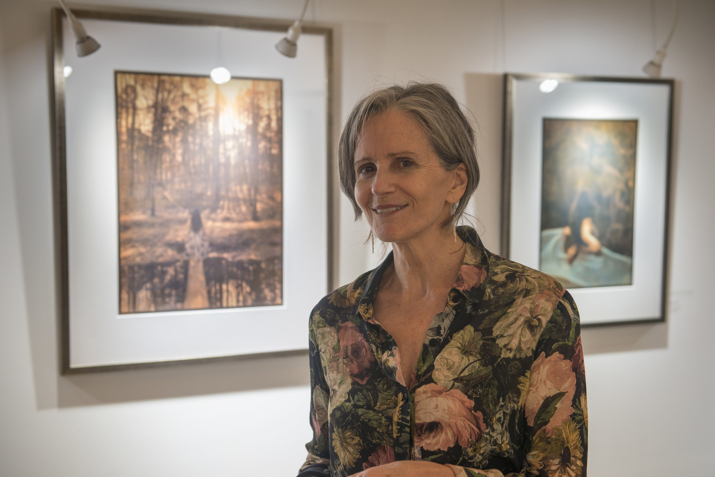 Diana H. Bloomfield with her work at the opening reception.
