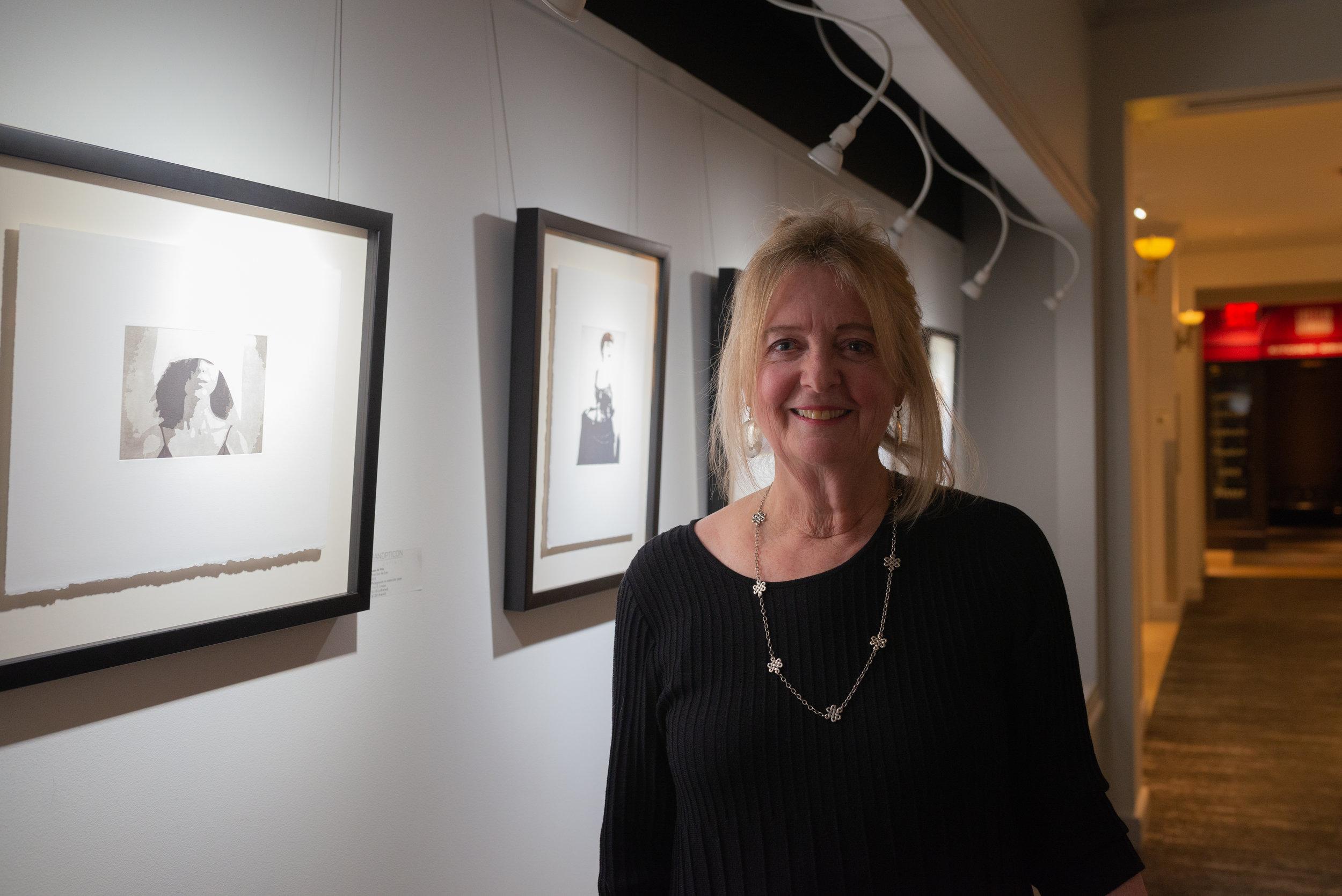 Susan De Witt, portrait in front of work.