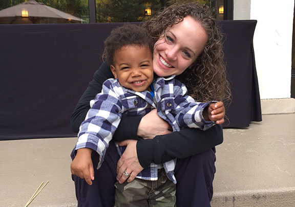 Stephanie gives her son DeMario a hug.