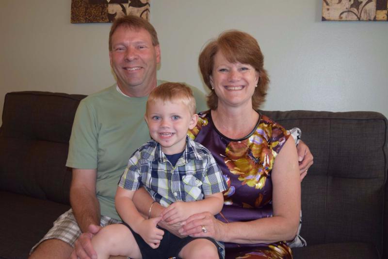 Pamela with her husband, Stan, and grandson, Jackson.