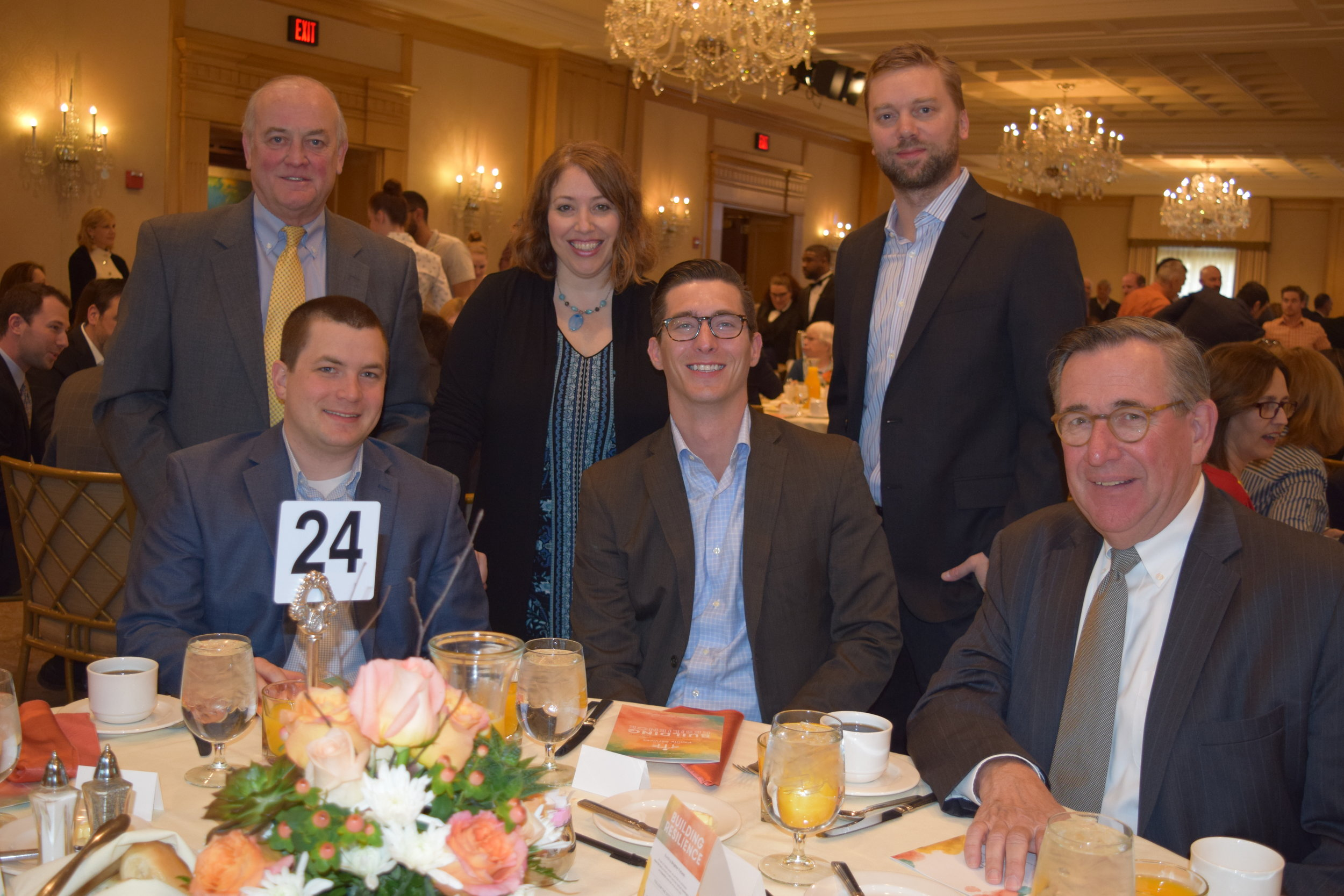 Board member Dan Pienta and guests of  KPMG Recrutement , a breakfast sponsor, attended the event.