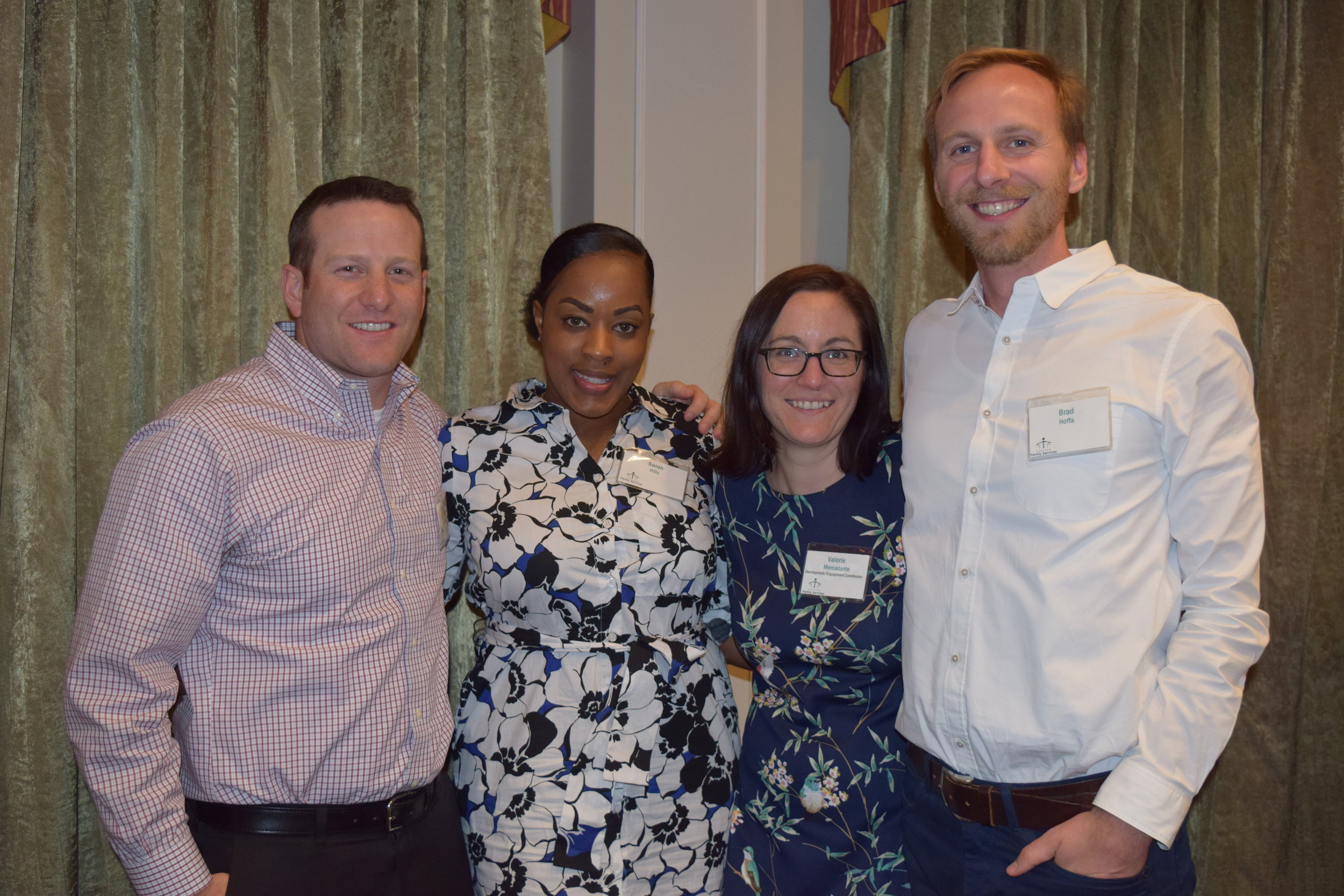 FCA US employees Nick Lang, Sarah Hills and Brad Hoffa with Valerie Mercadante, development and engagement coordinator at Oakland Family Services.