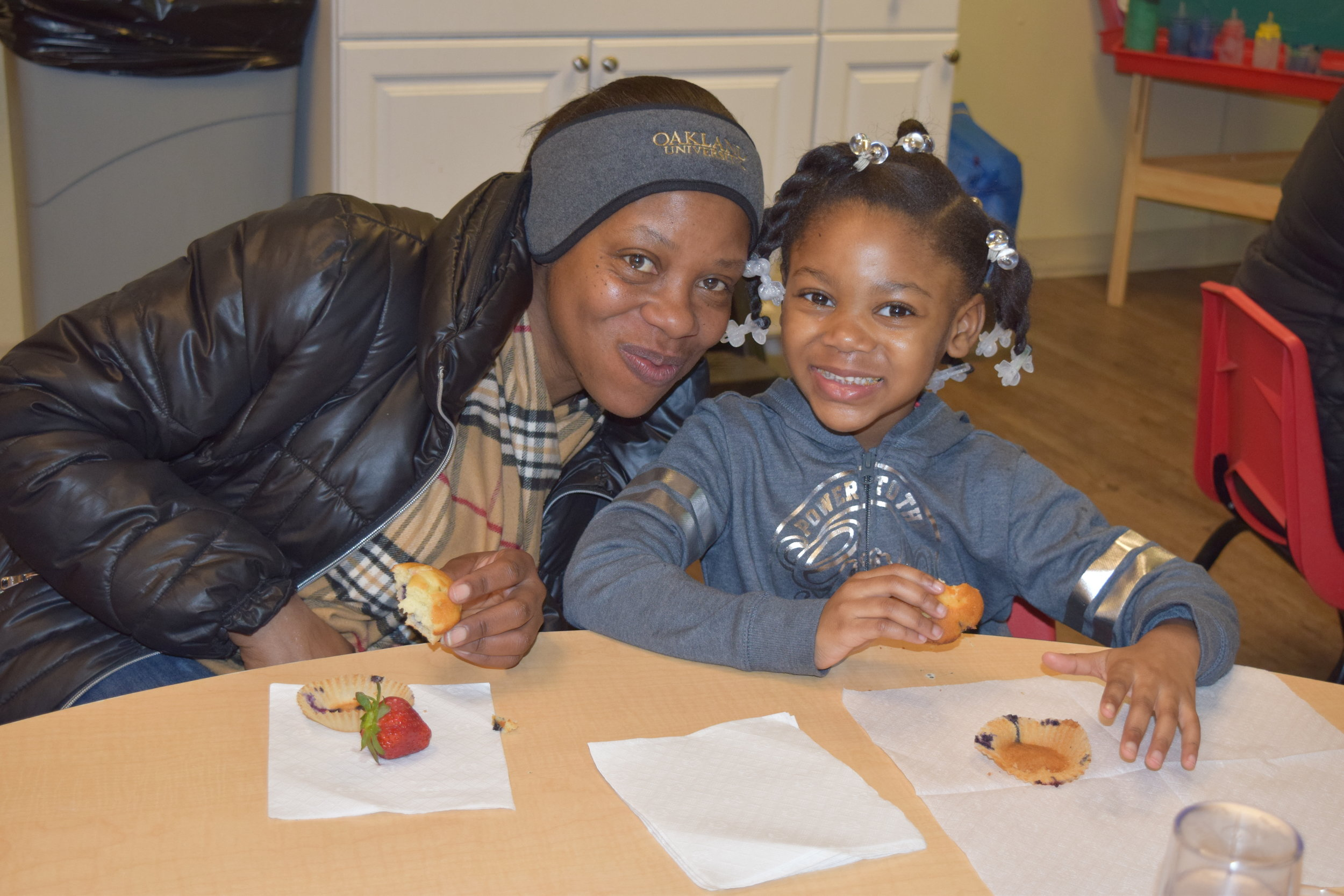 Jamyia Sherrell and her daughter, Journey, enjoy spending time together during Muffins with Mom at the Children's Learning Center in Pontiac.