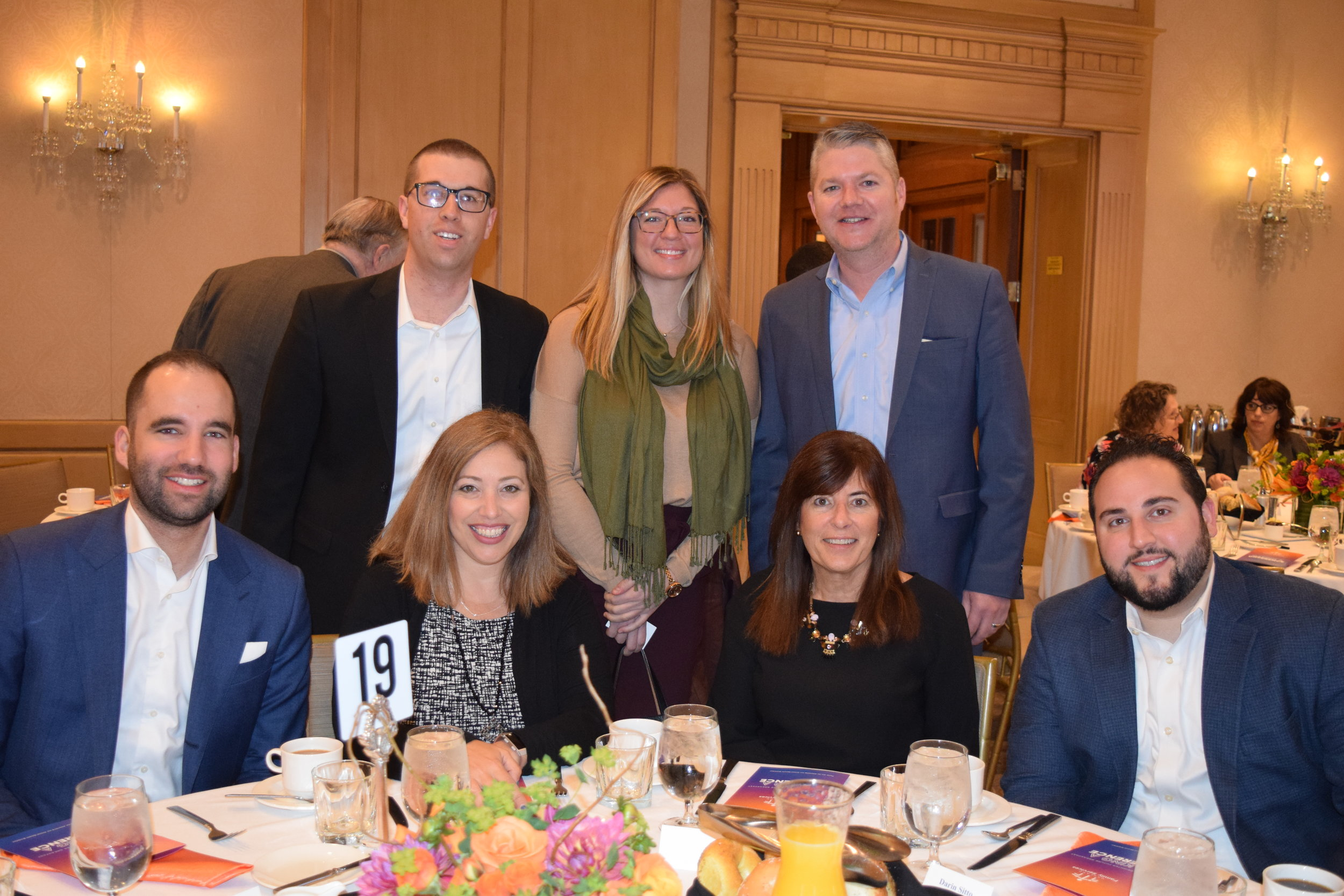 Representatives of breakfast sponsor KPMG, including board member Betsy Meter (front, second from right) attended the event.
