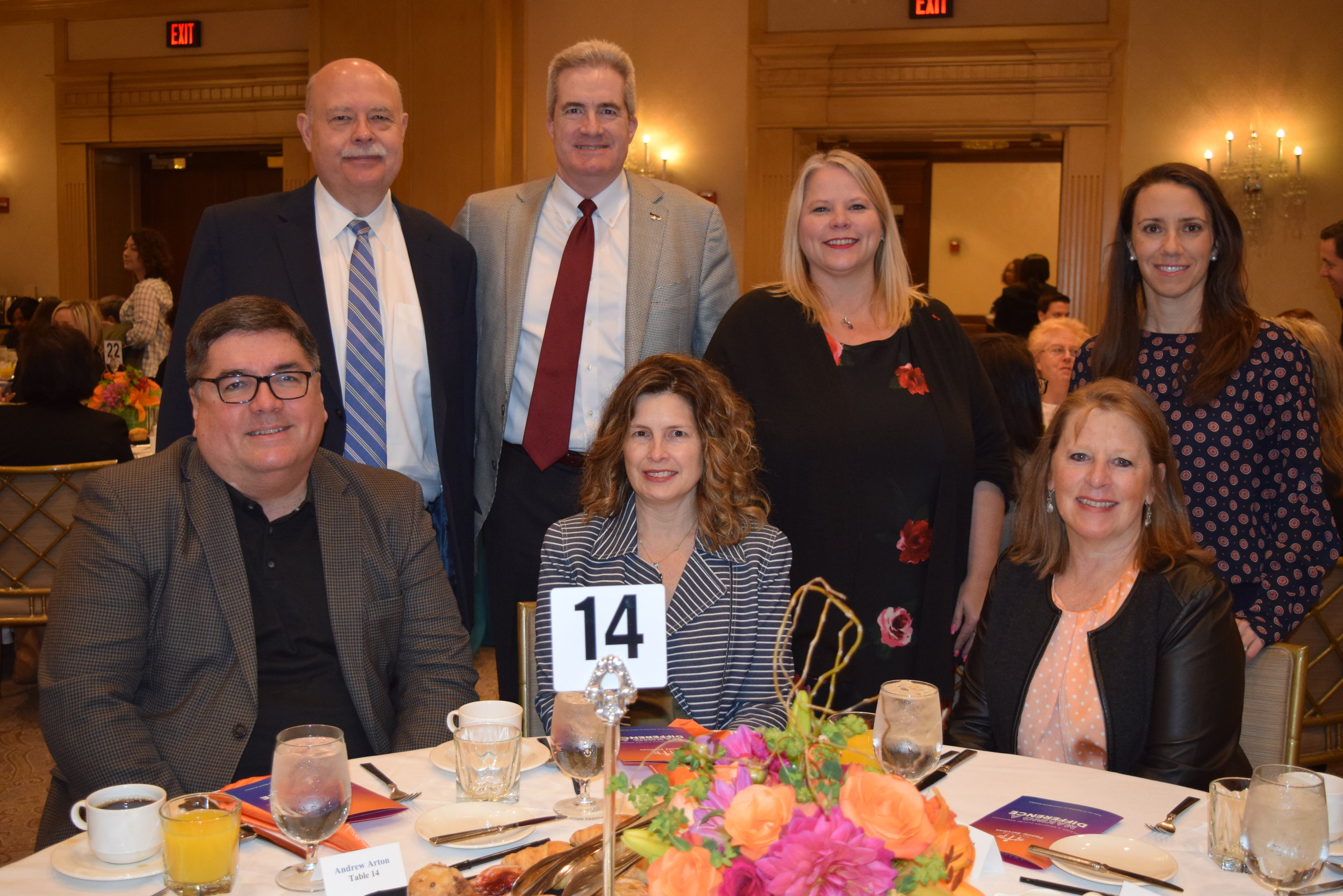 Representatives of breakfast sponsor KeyBank, including board member Ted Willett (top row second from left), attended the event.