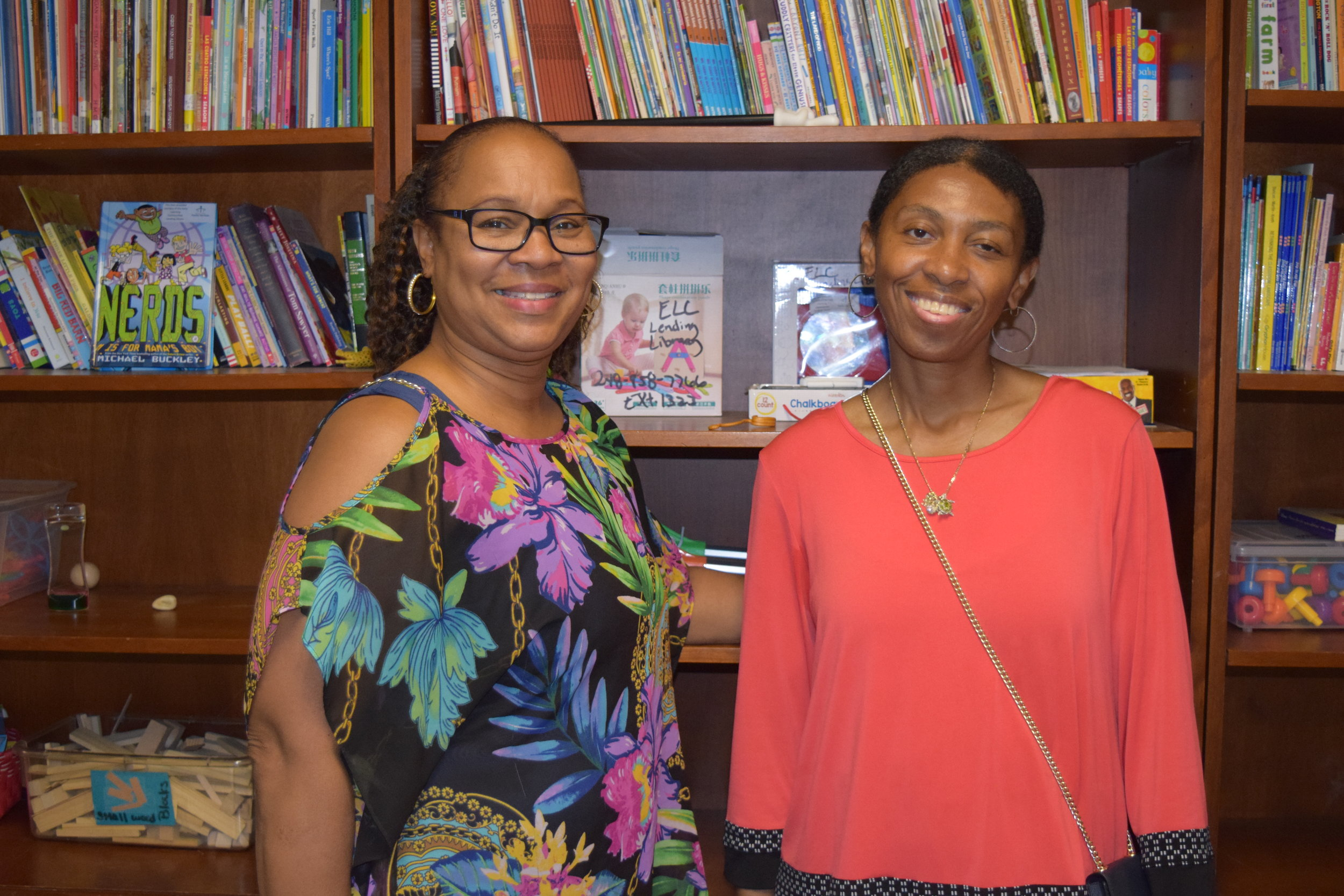 Children's Learning Center Lead Teacher Carolyn Moody (left) with Monica.