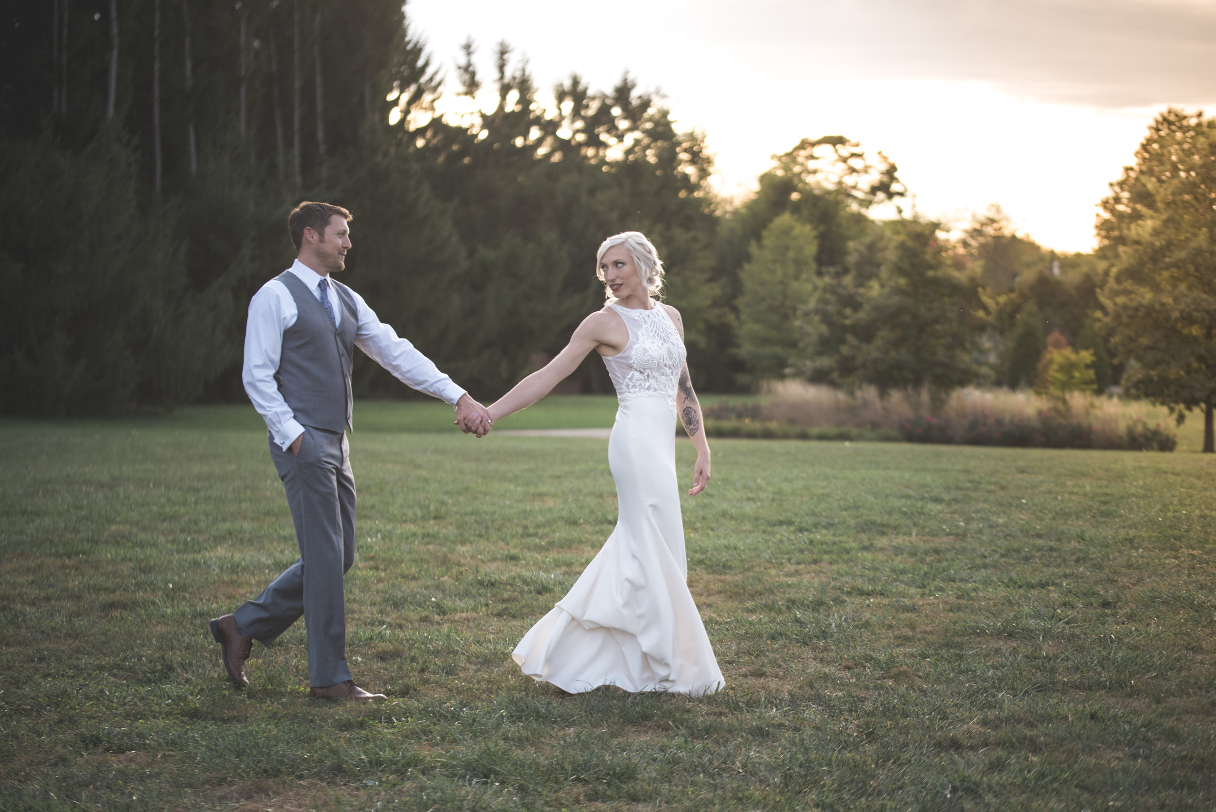 Bride and groom walk in a natural portrait