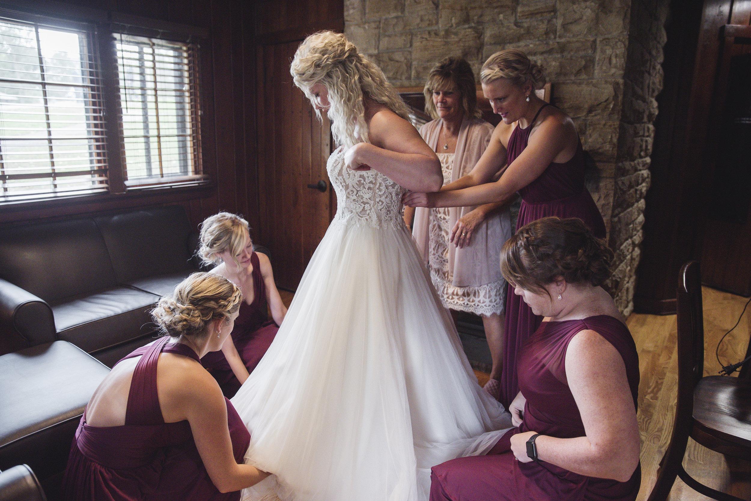 bride getting ready grove city wedding photographer